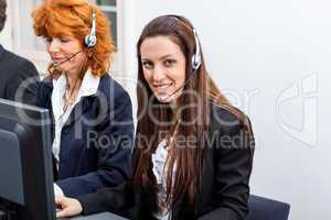friendly callcenter agent operator with headset telephone