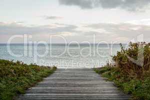 Bridge or pier across an expanse of sea