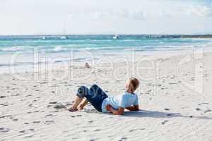 young man is relaxing on beach in summer vacation
