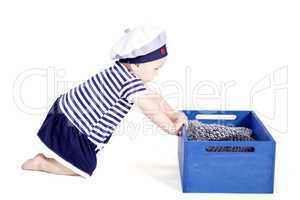 cute little baby in sailor fashion playing