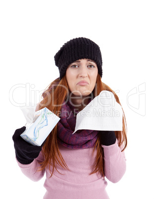 woman with tissue and spray feels unwell with flu