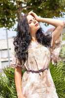 attractive brunette woman outdoor in summer sunshine