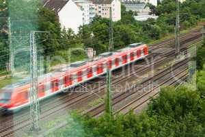 Fast moving train with red stripe