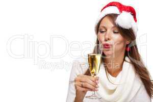 Playful woman celebrating Xmas blowing a kiss