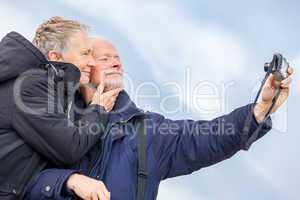 Elderly couple taking a self portrait