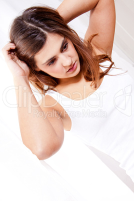 brunette woman in sunlight at window looking sensual