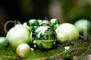 shiny green christmas baubles closeup macro and tree