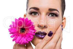 Beautiful woman in purple make-up