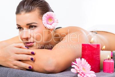 Beautiful woman enjoying a hot stone massage