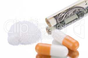 illegal pharmaceutical pills and drugs money on mirror