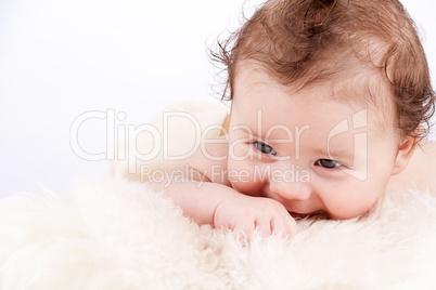 cute little baby infant toddler on white blanket portrait