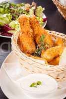 Crisp crunchy golden chicken legs and wings