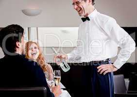 man and woman for dinner in restaurant
