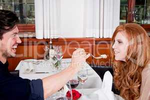 happy couple in restaurant or dinner