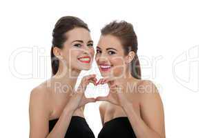 two beautiful girls with colorful makeup isolated