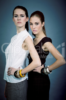 two beutiful brunette girls in casual fashion and accessory