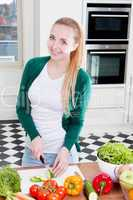 young woman cooking vegetarian food
