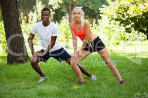 young couple runner jogger in park outdoor summer