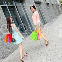 attractive young girls women on shopping tour
