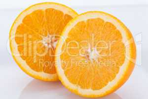 Fresh orange halved to show the pulp