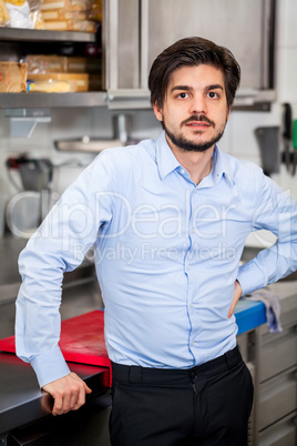 Friendly attractive man in a commercial kitchen
