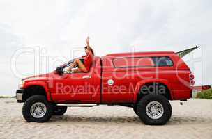 Sexy woman travelling on the red jeep