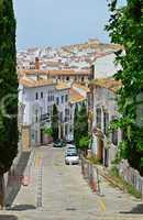 Steep street of Spanish white town Antequera