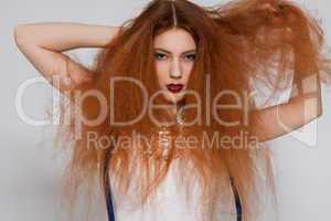 Female model playing with frizzy hair