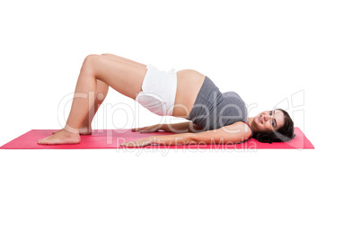 Active pregnant woman working out