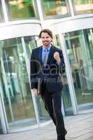 Motivated businessman punching the air