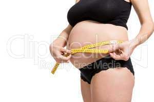Pregnant woman measuring her abdomen