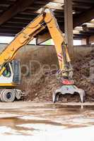 Heavy duty excavator doing earth moving
