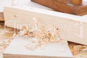 Handheld wood plane with wood shavings