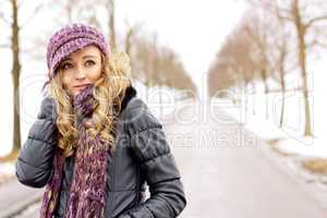 young woman outside in winter in snow cold