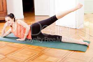 young attractive woman doing pilates