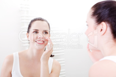 apllying cream on face skincare