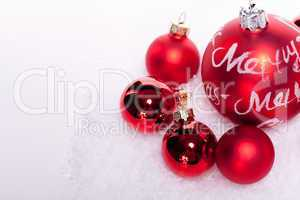 christmas decoration festive red bauble in snow isolated