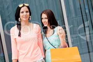 two attractive young girls women on shopping tour