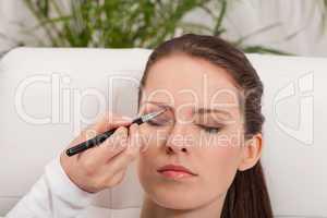 young attractive woman makeup eyebrow powder shadow applying