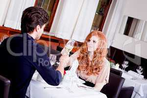 happy smiling couple in restaurant celebrate