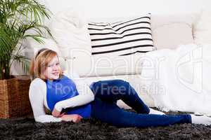 happy teenager girl smiling sitting on couch