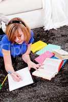 happy teenager girl doing homework