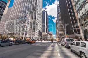 NEW YORK CITY - JUNE 12, 2013: Locals and tourists walk along ci