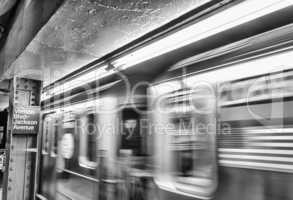 American flag on a fast moving subway train