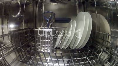 Dish washing machine with water streams, inside view