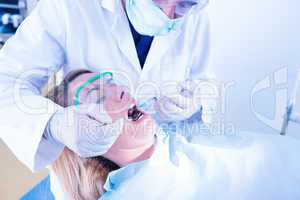 Dentist about to give injection to patient