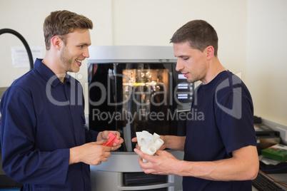 Engineering students using 3d printer