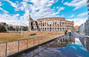 Water reflections of Colosseum with blue sky, Rome