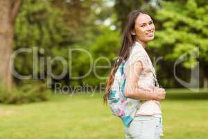 Portrait of a smiling student with a shoulder bag