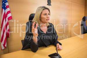Stern judge speaking to the court